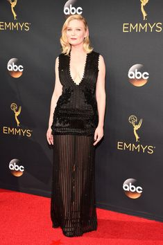 'Fargo' star Kirsten Dunst rocked a flapper-like black, sequined dress with a plunging neckline and a sheer skirt. Wow! (Photo by Kevin Mazur/WireImage)  via @AOL_Lifestyle Read more: http://www.aol.com/article/entertainment/2016/09/18/emmys-2016-winners-list/21474458/?a_dgi=aolshare_pinterest#fullscreen