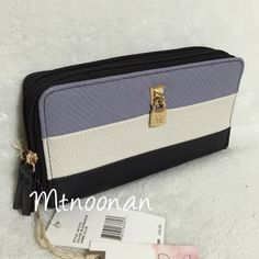 """Jessica Simpson Ellie Double Zip ColorBlock Wallet NEW WITH TAGS Jessica Simpson Ellie Double Zip Around Color Block Wallet  OTHER COLORS AVAILABLE!  • Fits iPhone 6 Plus  • Color: Black / Periwinkle / Ecru • Dimensions: 8"""" x 4"""" x 1.5"""" • Double zip around closures • 11 credit card slots • 4 slip pockets • 2 expandable sections • 1 zipper compartment  • Gold tone hardware • MSRP $45.00   I have more JESSICA SIMPSON, Check out my other items!  ❌ NO TRADES ❌ PRICE FIRM   FOLLOW ME ON INSTAGRAM…"""