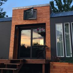 A 400 sq ft tiny house made from two seperate trailers and joined by an enclosed porch. Designed and built on Tiny House Nation.