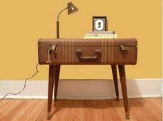 http://loffee.com/2013/06/05/diy-retro-furniture-12-things-to-do-with-vintage-suitcases/