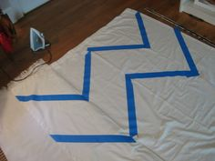 Use tape and fabric paint to make chevron curtain