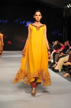 Yellow and red.. beautiful flowing Pakistani dress..