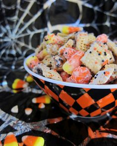 Halloween Chex Mix  8 oz white chocolate chips  4 cups Corn Chex cereal  2 cups bite-size pretzel twists  1 cup candy corn M/mini Reese's PB cups  1 cup candy corn  1/4 cup orange and black sprinkles