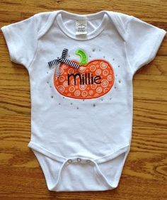 Custom Embroidered Fall Halloween Pumpkin Onesie! Custom Embroidered Baby Onesie, Baby Tee's & Toddler Tee's! Message Me for Your Custom Vinyl & Embroidered Onesie & Toddler Shirt! All Onesies & Toddler Shirts Can be Customized with Rhinestones, Bows, Different Teams, Colors, & Patterns! Makes for a Perfect Gift for Baby Showers, New Baby, & Birthdays! www.petesboutique.etsy.com