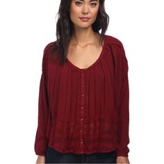 Free People Ruby Peasant Top Lightweight gauze constructs this flowing swing top. Semi-sheer construction. Scoop neckline and long sleeves with elastic cuffs. Sheer detailing at hem with plaid accents. Button-front closure. 100% rayon. No trades. Generous discount with bundle. Free People Tops