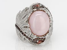 Oval Peruvian Pink Opal Cabochon With .68ctw Pear Shape And Round Vermelho Garnet(Tm) Silver Ring