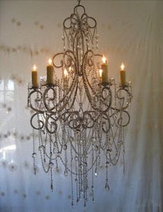 Gorgeous vintage four-arm chandelier with delicate glass stem and scalloped glass crystals