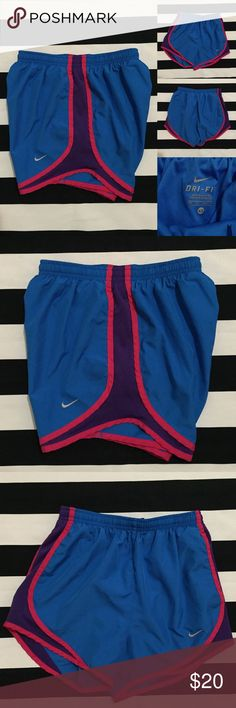 "[nike] women's DRI-FIT athletic shorts szXS [nike athletic shorts] •listing •great used condition •size extra small •blue with pink and purple detail and blue liner •length/inseam 3"" •elastic drawstring waistband with small pocket •material is polyester •see other nike and athletic listings in my closet •Offers are welcomed using the offer feature and/or bundle for a great deal Nike Shorts"