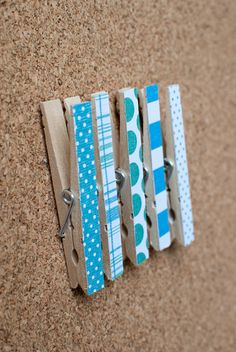 Cork Board Clothespins: tack glued on back, paper glue to front, automatic hangers/clips