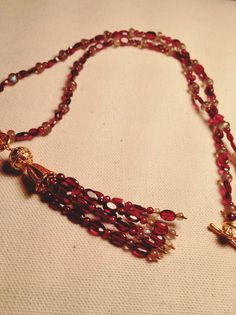 Garnet tassel on garnet necklace