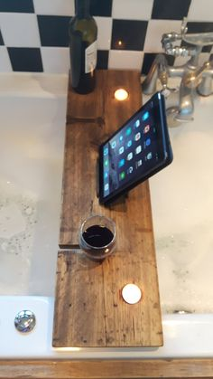 Welcome to Spuds Creative Asylum. This bath shelf is perfect for relaxing in the bubbles, with a good book (or tablet), a glass of wine and some ambient lighting. The book/tablet holder is made from sturdy steel rebar, the shelf itself is made from reclaimed wood and coated in Danish oil to protect from steam and water and keep this looking beautiful. Each shelf has two recesses to hold tealights and two wine glass slots, should you wish to place your glass on the left or right side. The...
