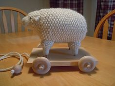 Old Fashioned Sheep Toy.  Free pattern on Ravelry includes instructions for plush sheep stand-alone and as a pull toy.