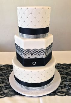 Classic elements (quilting and lace) combined with a more modern twist (alternating shaped tiers with a little bling) for a beautiful look! #blackandwhitewedding #laceweddingcake #weddingbling #rhinestones #sweetlifepatisserie