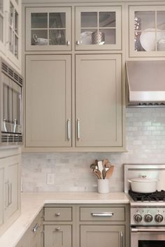 Carrera Subway Tile Backsplash | Carrera Marble Subway Tile | gray cabinetry