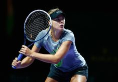 Maria Sharapova Photos: BNP Paribas WTA Finals: Previews. Maria Sharapova of Russia in a practice session during previews for the WTA Finals at Singapore Sports Hub on October 18, 2014 in Singapore.