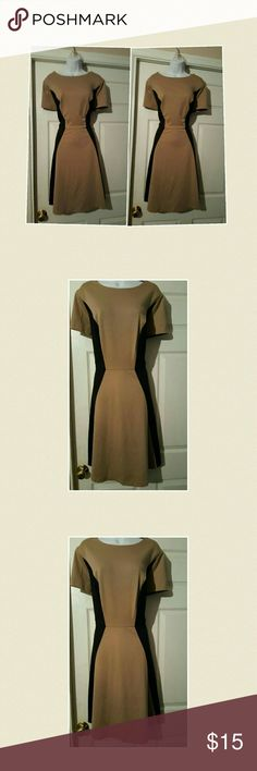 Black & tan  colorblock ponte knit fit&flare dres SOHO black and tan  colorblock ponte knit fit&flare dress with high round neckline and cap sleeves. Dress isvin excellent like new condition soho  Dresses