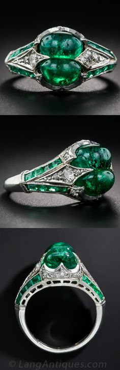Art Deco Twin Emerald, Diamond and Platinum Ring,The perfect couple! Art Deco opulence is embodied by a pair of rich, vibrant-green cabochon-cut emeralds, together weighing 3.25 carats, glowing at the apex of a diamond and emerald-studded jewel. A mingling of old mine, European and Swiss-cut diamonds are nestled within scalloped spires of platinum, accentuated by twin channels of calibre emeralds. Circa 1920s.