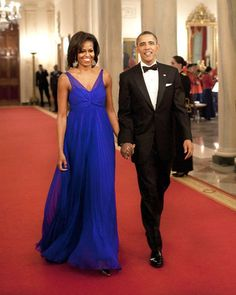 President Barack Obama and First Lady Michelle Obama walk through the Cross Hall to the East Room of the White House in Washington. Obama and his wife Michelle hosted a dinner for members of the US armed forces who served in Iraq and Afghanistan.