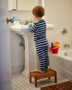 A CUP OF JO: Motherhood Mondays: Brushing kids' teeth. Tips and a link to a Sesame Street video that encourages kids to brush.