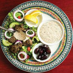 My Version: meze platter with cukes, pepperoncinis, olives, feta or goat cheese, cucumber dip with Greek seasoned meatballs