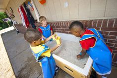 The big kid playground has a water table for learning and discovery every day.