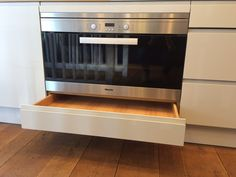 Underneath this extra-wide Miele oven is a narrow drawer, ideal for storing baking sheets and trays. This forms part of a sleek display of Pure cabinetry at our Muswell Hill showroom. Base cabinetry is shown here in Earl Grey. http://www.john-lewis.co.uk/kitchens/contemporary-pure-kitchen