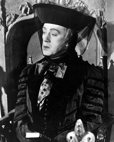 "Alec Guinness playing an elderly woman--one of eight roles he plays in ""Kind Hearts and Coronets"", directed by Robert Hamer 1949."