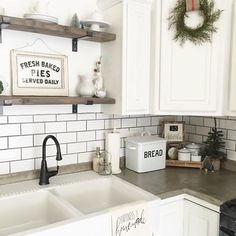 Farmhouse kitchen design with white subway tiles, concrete counters, and apron sink