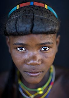 Muhacaona ( Mucawana) tribe girl. The haircut is made with a mix of dried cow dung, fat, and herbs for the fragrance.