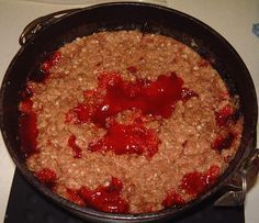 This chuck wagon style cherry crisp makes me want to go camping NOW! from Dale Smith's Great Meals Dutch Oven Style.