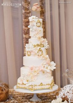 Gorgeous pink & gold wedding tower cake.  Not too sure about the macaron topper though.