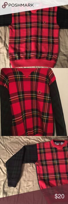 Tommy Hilfiger Size L Flannel Sweater Used Tommy Hilfiger sweater. Front area of sweater has red flannel design as the arms and back of it have a dark green flannel design. Tommy Hilfiger Sweaters Crewneck