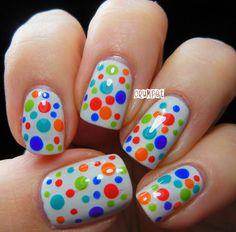 Polychrome polkadots on white manicure