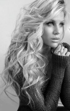 She's gorgeous. I love her hair, makeup, ring and sweater too.