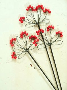 Wire flowers; for the garden or would look nice in a small vase.