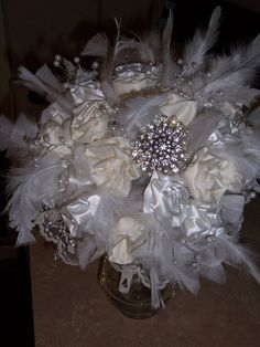 white and ivory feather bouquet including mt grandma's pin..just what i wanted..