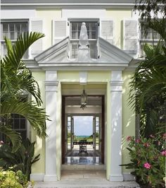 British colonial architecture with the always essential palms flanking the doorway.