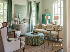 pretty colors. neutrals with soft blue/turquoise and great fabric on ottoman