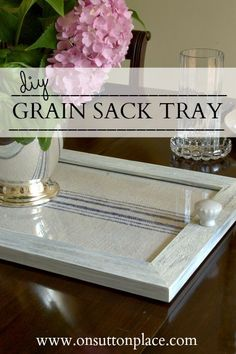 Make a tray from a picture frame and a grain sack. This would be nice with a piece of pretty fabric.
