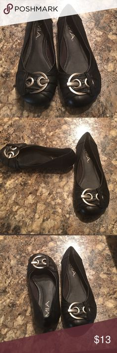 Black flats with buckle Flats are size 6.5. Color is black. Shoes has silver buckle in front. Has been worn but in good condition MIA Shoes Flats & Loafers