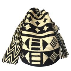These double thread Wayuu mochila bags are all made in the region of La Guajira, Colombia by indigenous Wayuu women. Mochila bags are a very important handicraft that helps sustain the indigenous Wayuu people. These bags take approximately 10 days to make. The craft of crocheting is learnt at an early age and passed down from generation to generation. The mochilas are a reflection of the everyday shapes that surround the lives of the Wayuu tribe. Buy yours at www.lombiaandco.com Tapestry Bag, Tapestry Crochet, Crochet Accessories, Handicraft, Fashion Bags, Purses And Bags, Crochet Patterns, 10 Days, Knitting