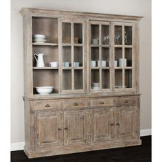 This rustic and contemporary Cabinet features a natural pine construction. Carved detailing along the base complements the casual look. Set includes: One (1) Cabinet Style: Casual Number of Shelves: T