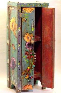 Perfectly imperfect and completely handmade and distressed standing cabinet. Painted and decoupaged with layers of love, floral images. And just