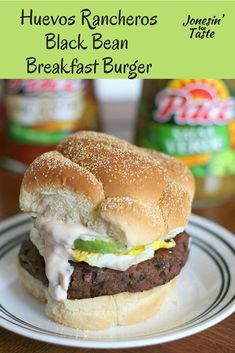 Huevos Rancheros Burger is an easy homemade black bean burger topped with a fried egg, sliced avocado, and a creamy salsa spread that brings some spice to breakfast.