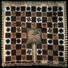 Death quilt or Graveyard quilt. University of Louisville KY.  1850-1875 Large center block is cemetery with coffins. Coffins also inside border which looks like a fence.