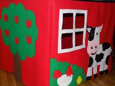 This Play House can fit on any standard size game table (the top of my table measures 34in. and it is 28in. tall). The front and 3 sides all have embellishments. All four sides are made of felt and all the embellishments are felt.  The front of the house has a barn door that opens and a mother duck and her two ducklings. The Left side of the Farm has a cute cow and chicken with her chick with a window. The right side has a friendly horse, flowers and another window that children can look out…