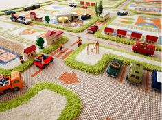 Fabulous three dimensional rug for the playroom with built-in roads for toy cars!