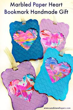 These Marbled Paper Heart Bookmarks would make such a great handmade gift. This is a great way to combine a craft for kids with a mom craft.. in this case, paper crafting, to create something really nice!