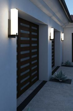 The elegant, contemporary Cosmo LED outdoor wall sconce by Tech Lighting features a rectilinear white acrylic shade with metal base. Creates soft up light to highlight structural features on an archit Modern Outdoor Wall Lighting, Led Outdoor Wall Lights, Outdoor Wall Sconce, Outdoor Walls, Modern Exterior Lighting, House Lighting, Club Lighting, String Lights, Backyard Lighting