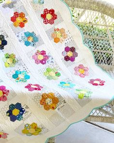 I just have to stop and take a minute because I'm going crazy over this Grandmother's Flower Garden quilt my mom made! It is in the June…